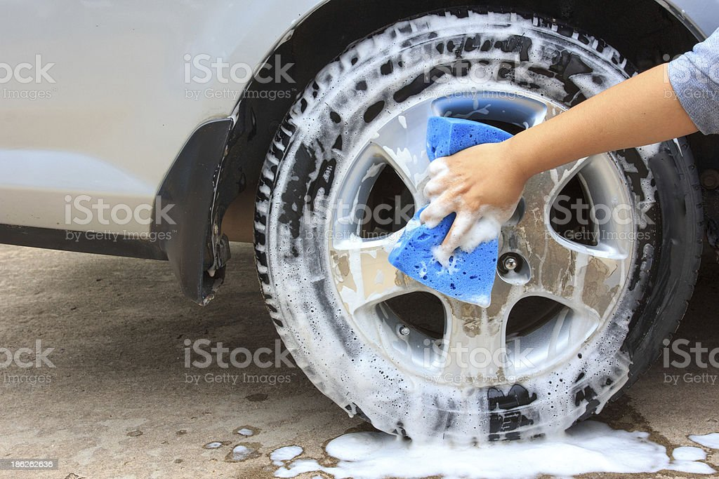 cleaning the wheel car wash with a sponge royalty-free stock photo