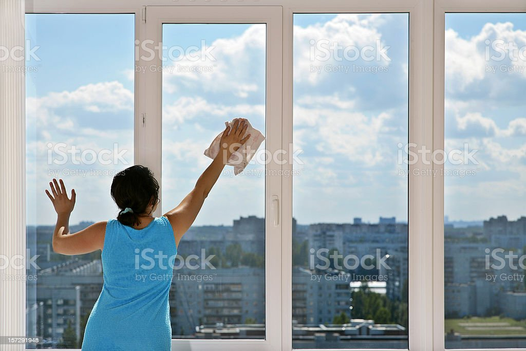 Cleaning the window royalty-free stock photo