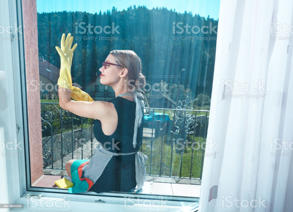 cleaning the windows in spring day stock photo