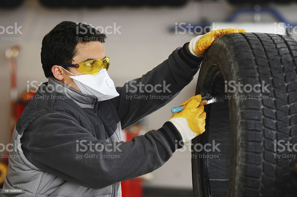 Cleaning tire stock photo