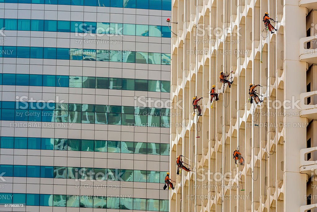 Cleaning up skyscraper in Duba? stock photo