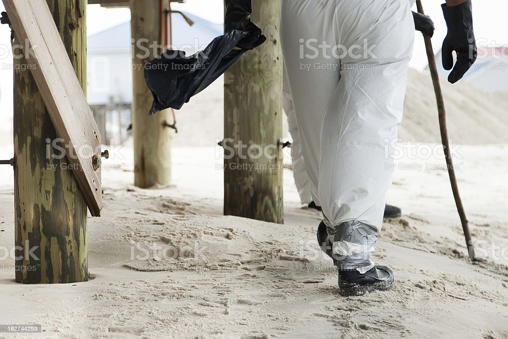 Cleaning up the beach royalty-free stock photo
