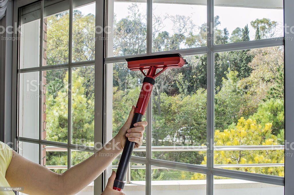 cleaning window with machine stock photo