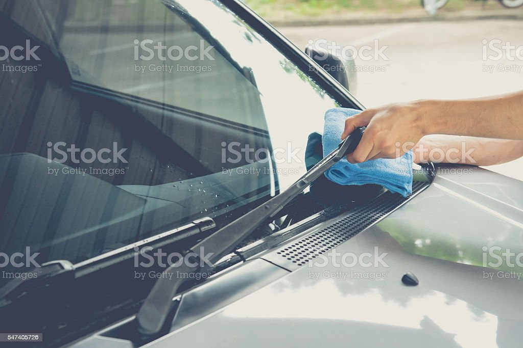 Cleaning windscreen wiper stock photo