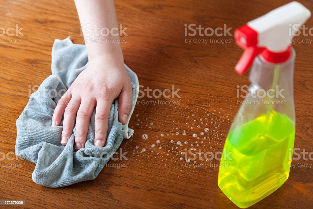 Cleaning wood surface stock photo