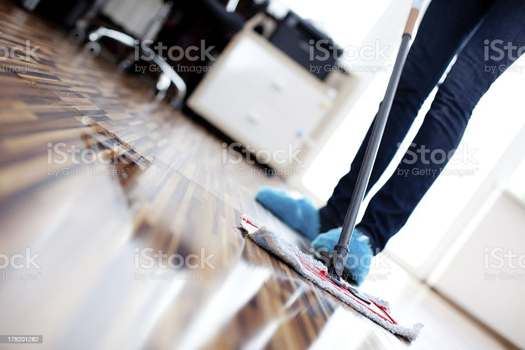 Cleaning wooden floor stock photo