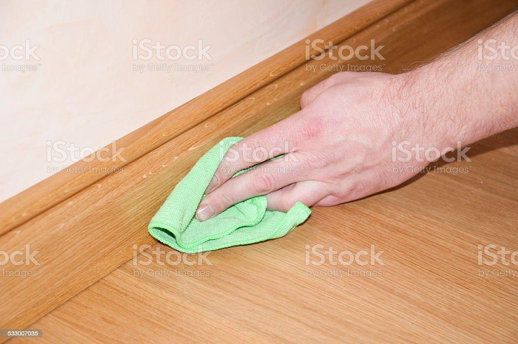 Cleaning wooden floor stock photo