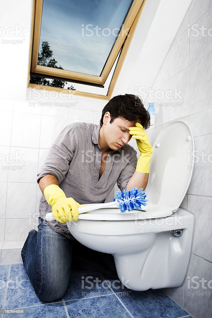 cleaning young man in bathroom royalty-free stock photo