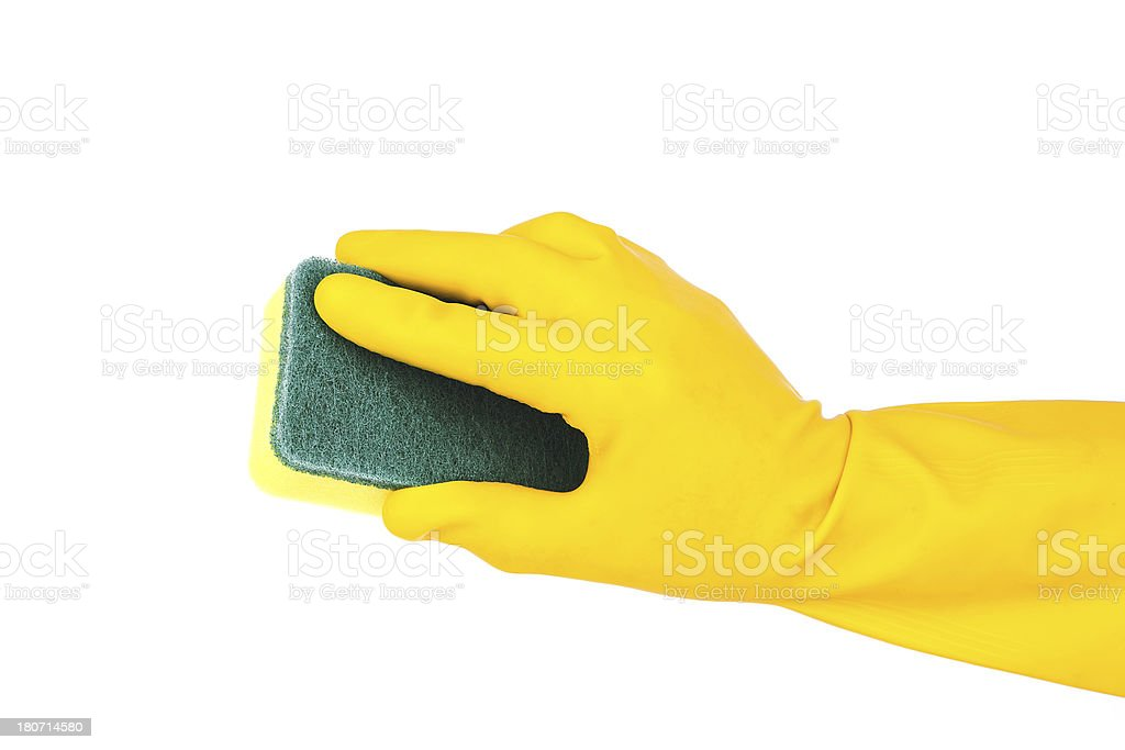 Cleaning:yellow glove and sponge isolated on white background royalty-free stock photo