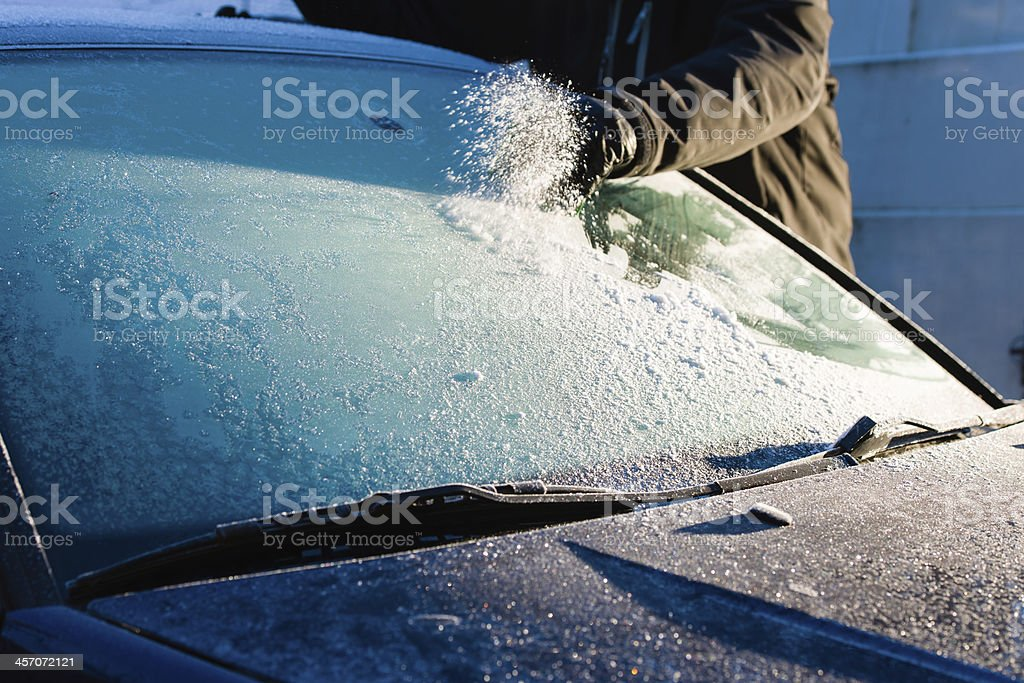 Cleans frozen windshield stock photo