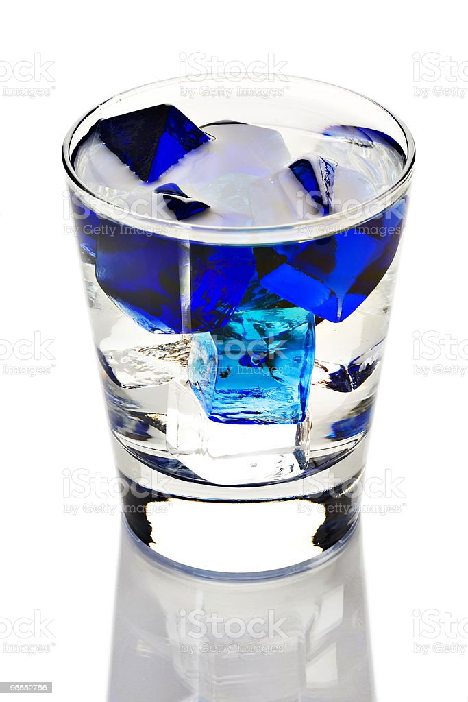 Clear beverage with blue ice cubes royalty-free stock photo