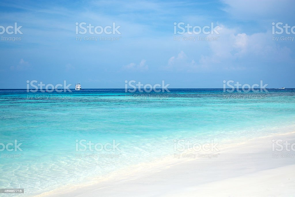 Clear blue sky with the sea and white sand. stock photo