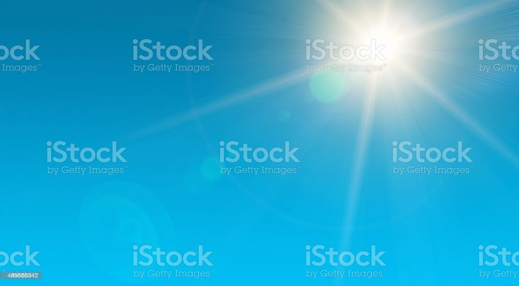 Clear blue summer sky with blazing hot sun stock photo