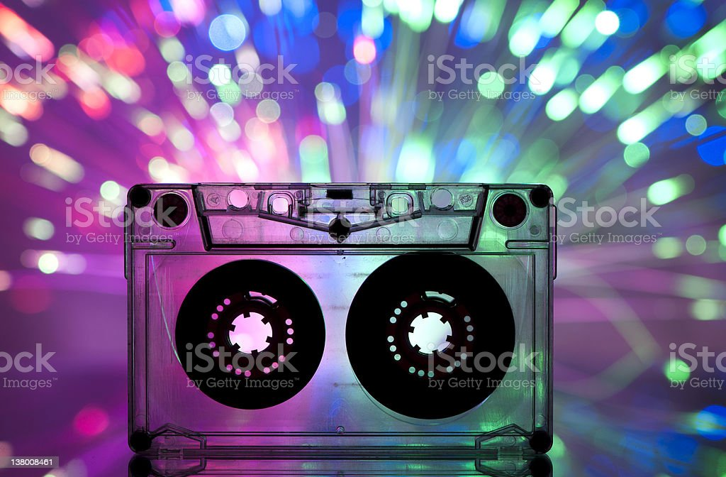 Clear cassette tape multicolored light background stock photo