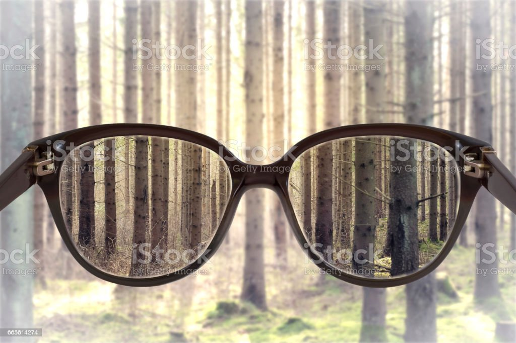 Clear cityscape focused in glasses lenses with blurred background stock photo