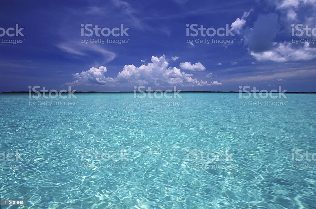 Clear, crystal-blue waters of a tropical lagoon royalty-free stock photo