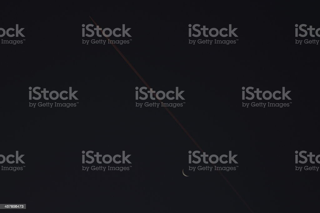 Clear Dark Sky, Moon, Red Condensation Trail of an Airplane royalty-free stock photo