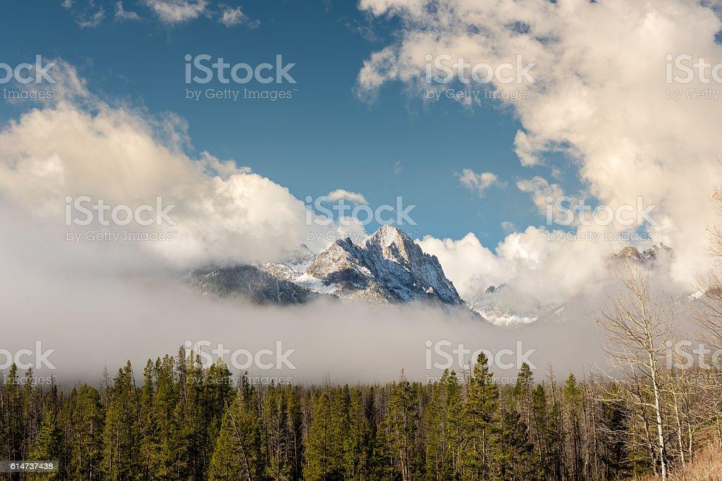 Clear fog around a high mountain peak stock photo