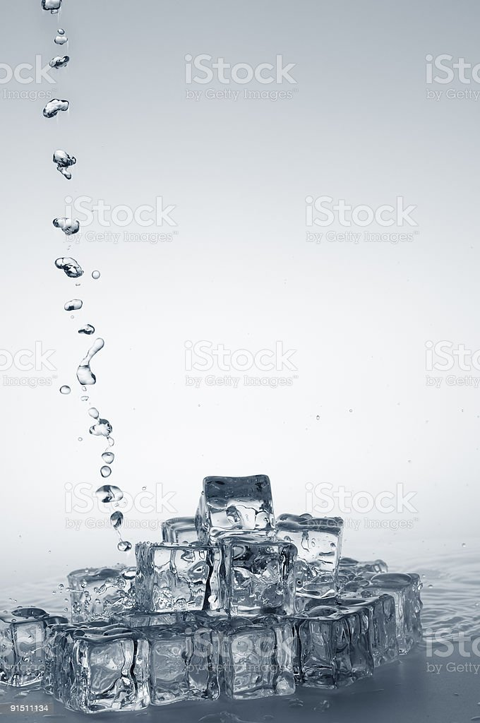 Clear fresh mineral water pouring on frozen crystal transparent royalty-free stock photo