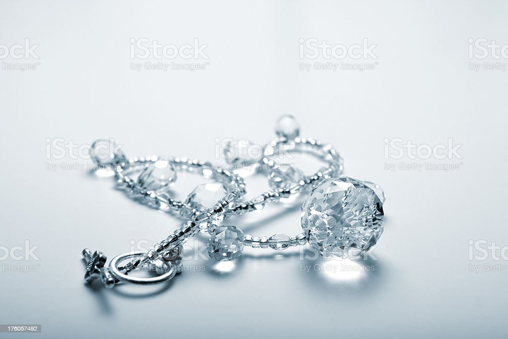 Clear Glass Bead Necklace on Light Background royalty-free stock photo