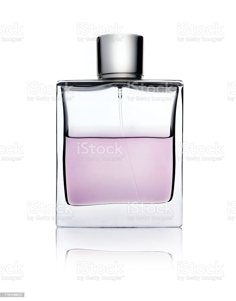 Clear glass bottle with pink perfume on white surface stock photo