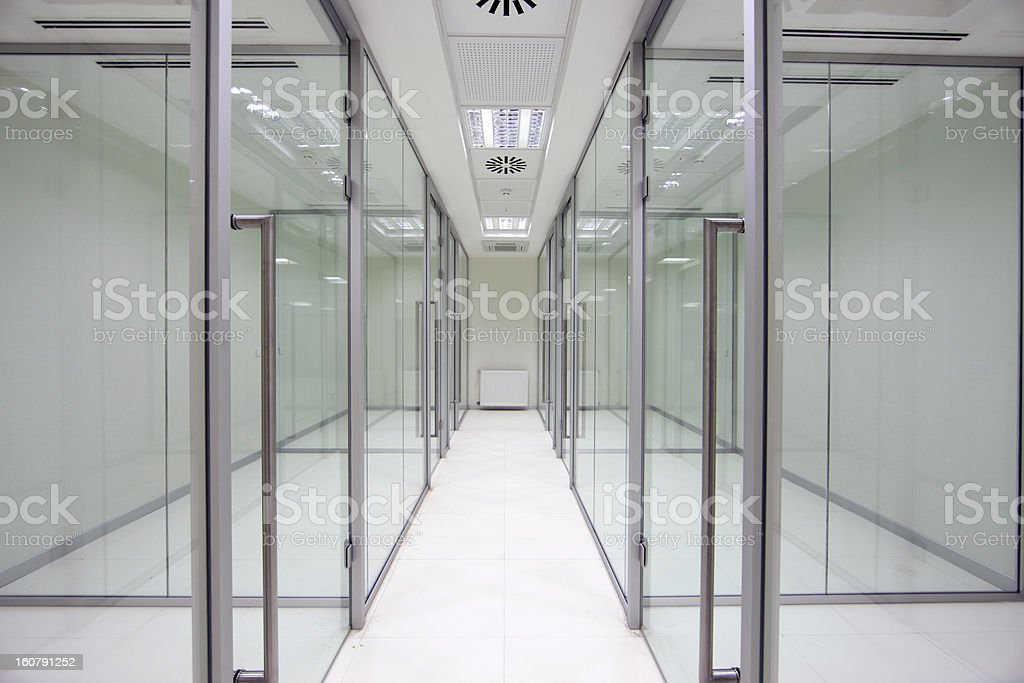 Clear glass chambers on two sides of the hallway stock photo