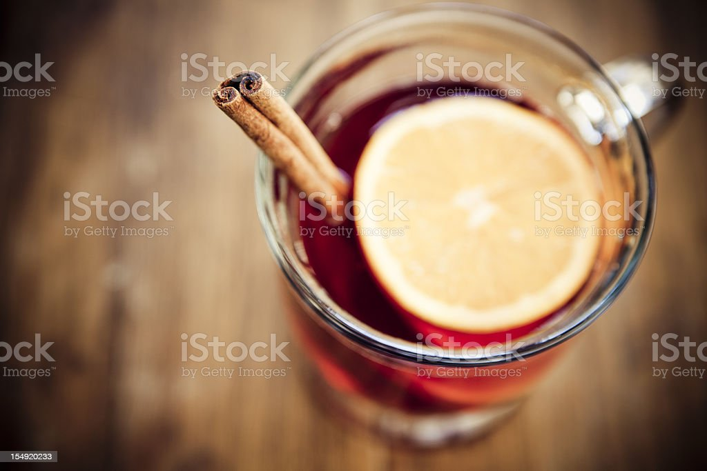 Clear glass cup of Mulled wine with cinnamon stick royalty-free stock photo