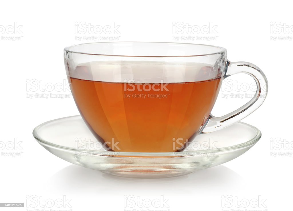 Clear glass cup of tea with clear saucer  stock photo