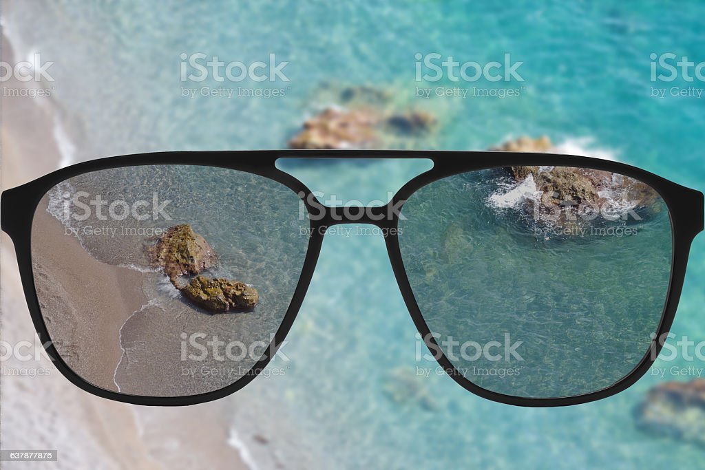 Clear image in sun glasses against blurry land sunny andscape stock photo