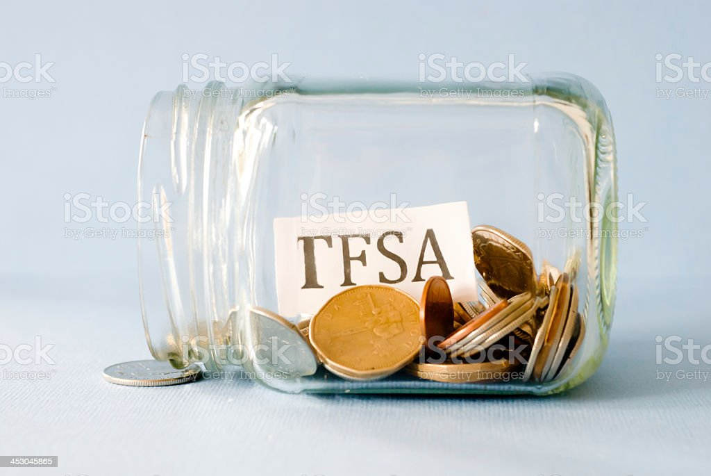 Clear jar of saving coins for TFSA royalty-free stock photo