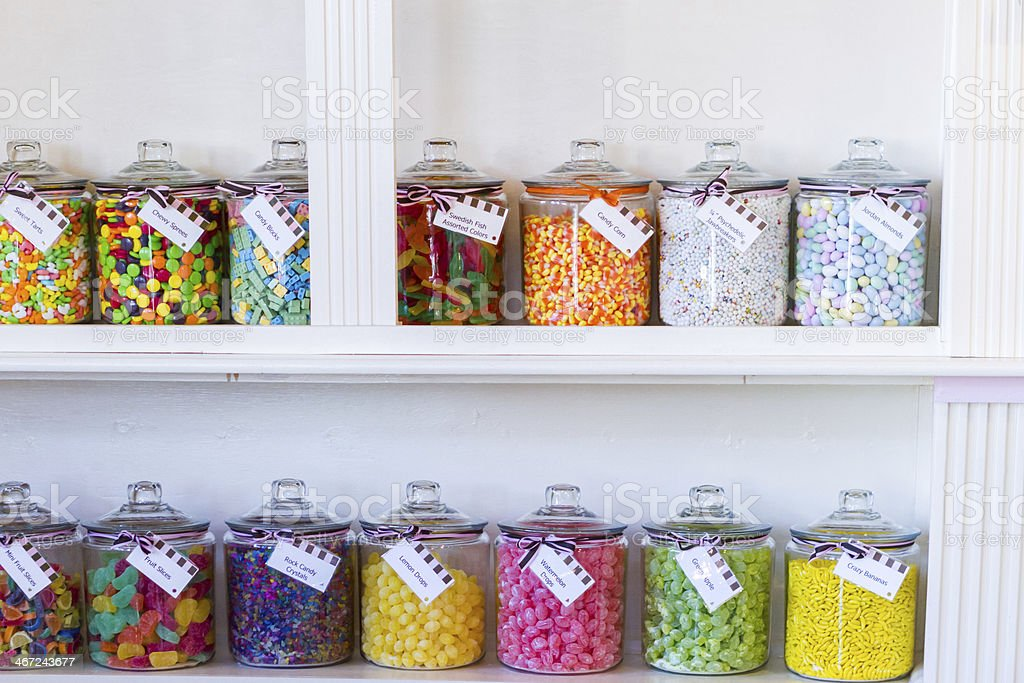 Clear jars filled with candy in candy store stock photo