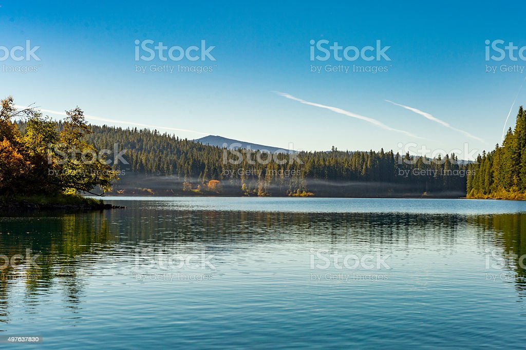 Clear Lake Oregon Lake with small amount Smoke from Campfires stock photo