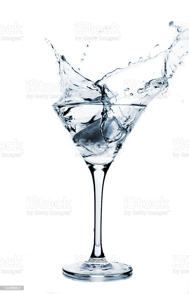 Clear liquid splashing into a martini glass royalty-free stock photo