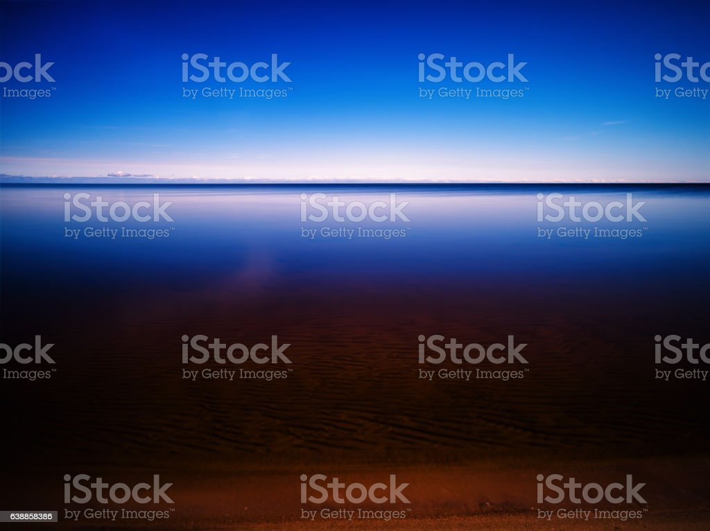 Clear morning at smooth mountain lake stock photo