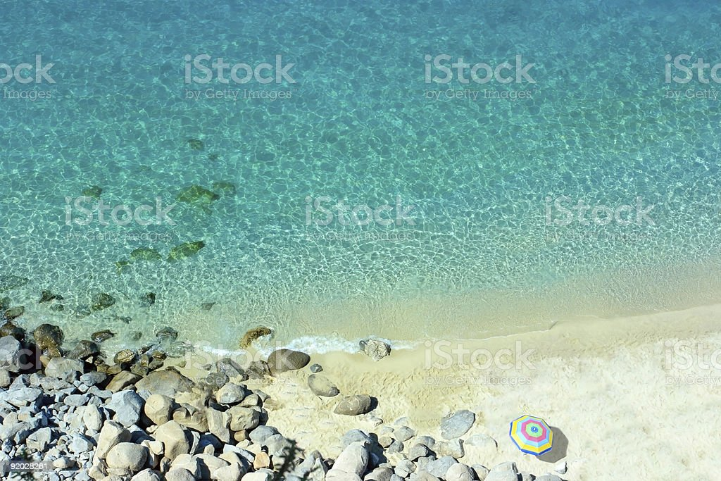 Clear ocean water and sandy beach royalty-free stock photo