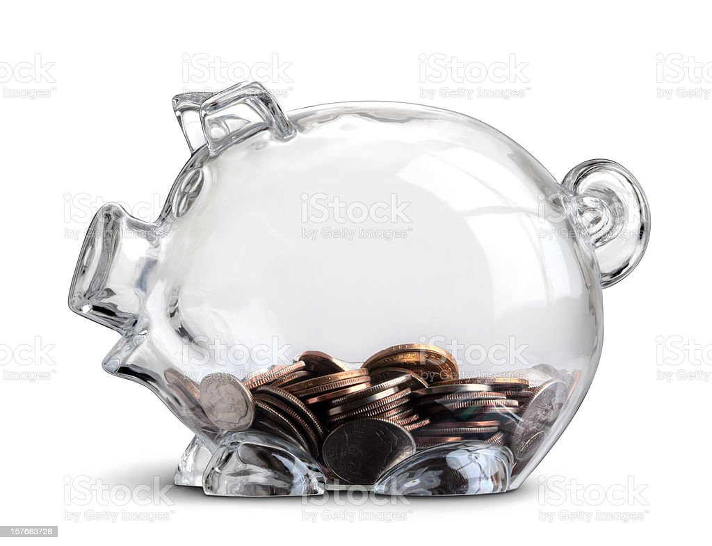 Clear Piggy Bank Showing Some Savings in Coins Isolated royalty-free stock photo