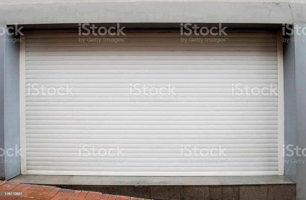Clear shot of a white rolling shutter rolled down stock photo