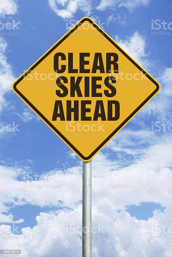 Clear Skies Ahead  - Warning Sign Against Sky with Clouds stock photo