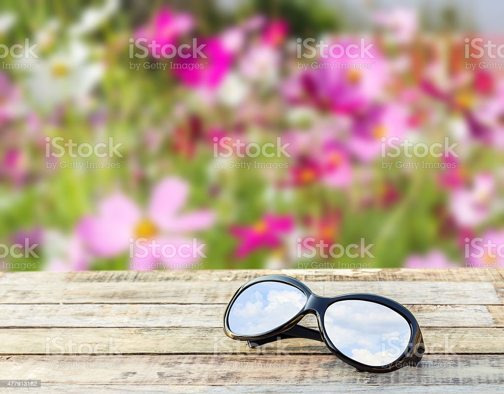 Clear sky in eyeglasses on the table over blurred backgro stock photo