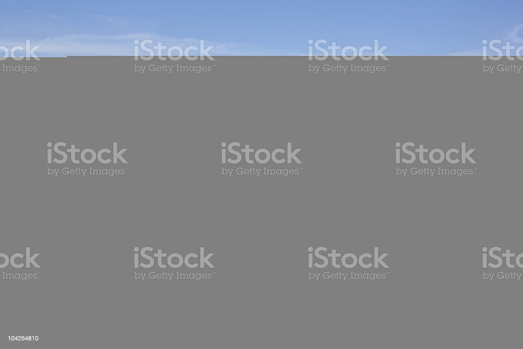 Clear sky over blank gray space stock photo