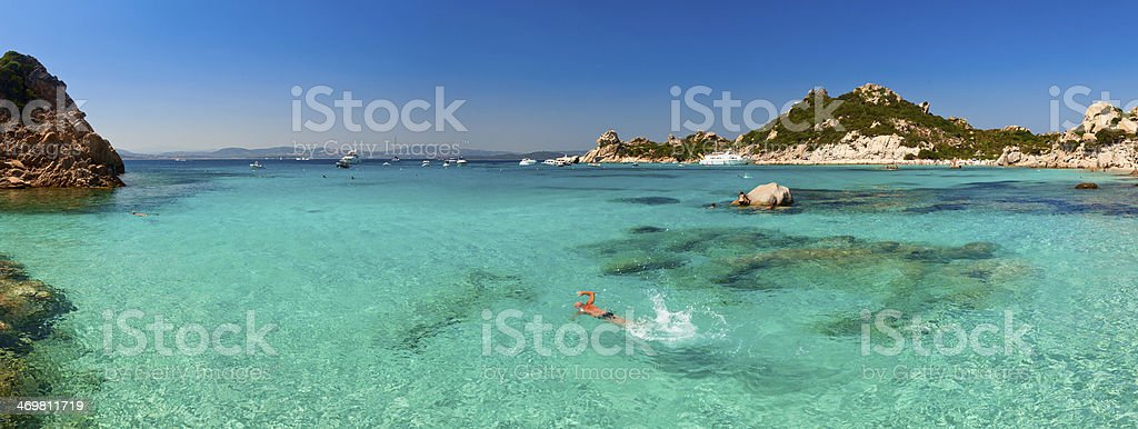 Clear turquoise water of Cala Corsara bay in Sardinia stock photo