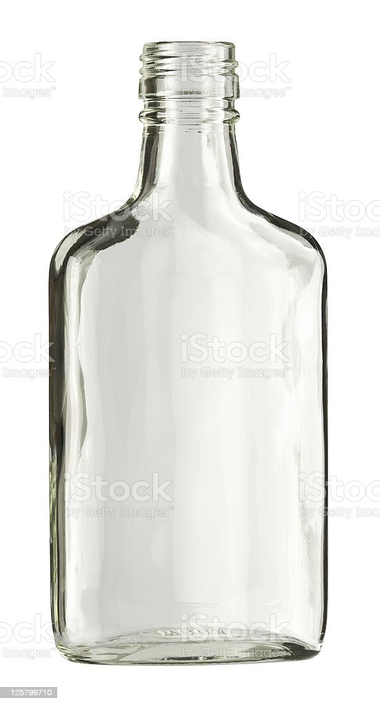 A clear unmarked glass liquor bottle stock photo
