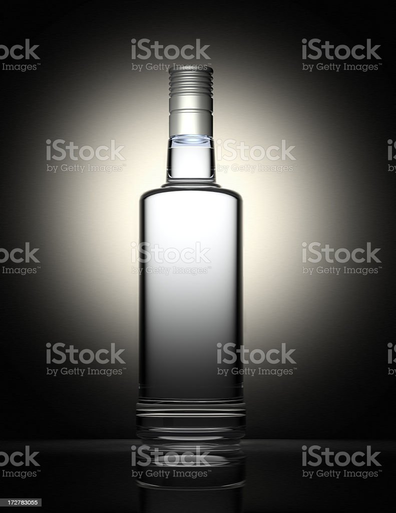Clear vodka bottle isolated on black and gray background stock photo
