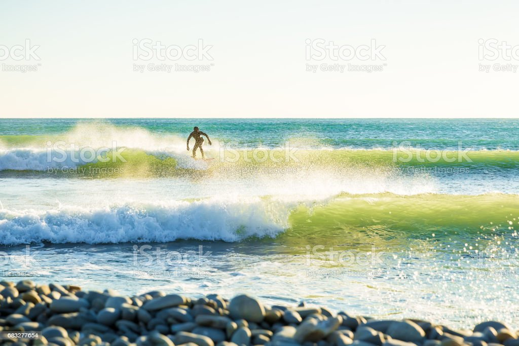 Clear waves and surfer on wave. Surfing in green waves. stock photo