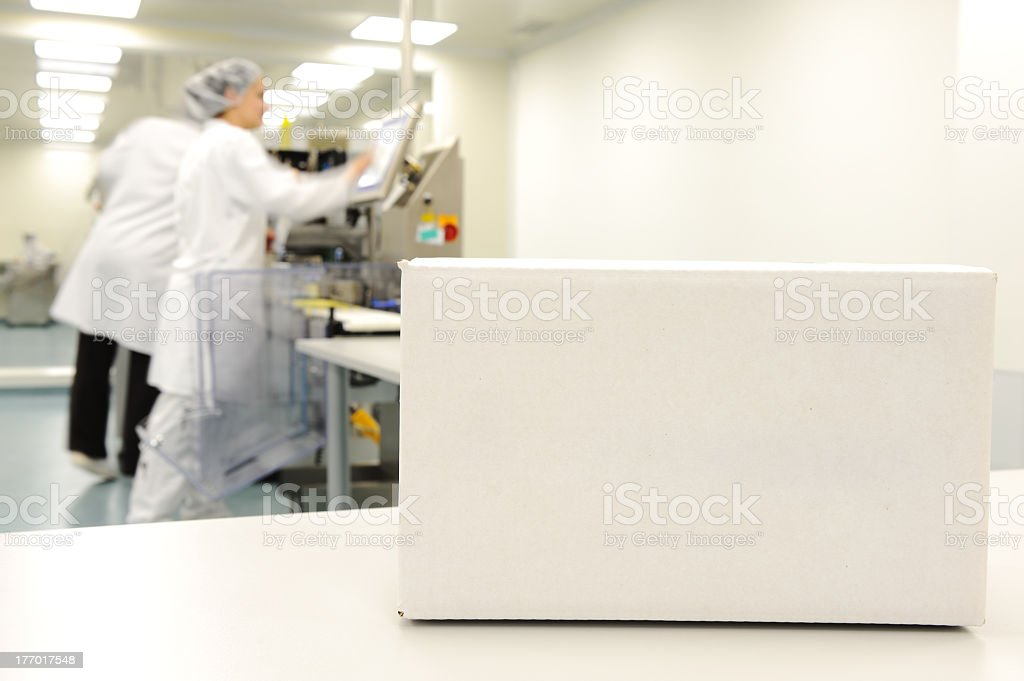 A clear white box at automated production line in factory stock photo