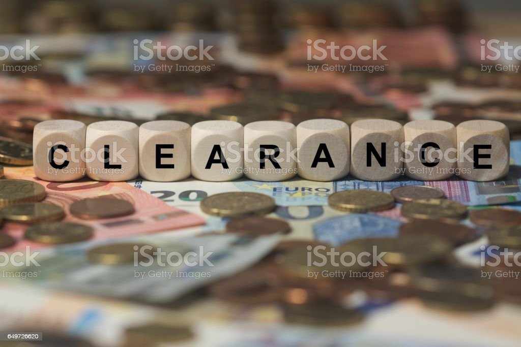 clearance - cube with letters, money sector terms - sign with wooden cubes stock photo