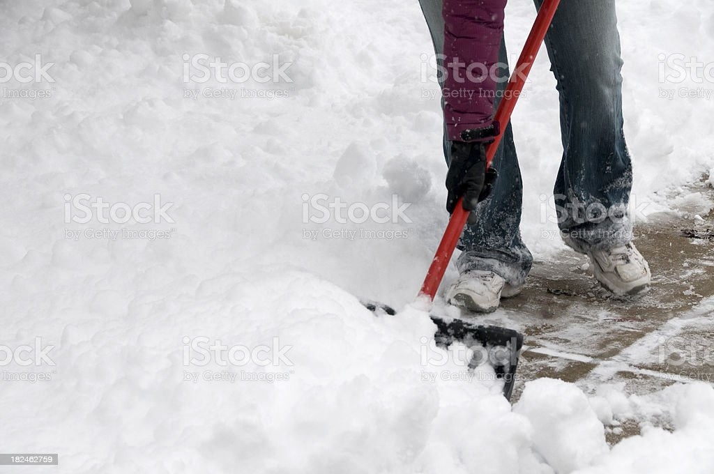 Clearing Snow from Sidewalk royalty-free stock photo