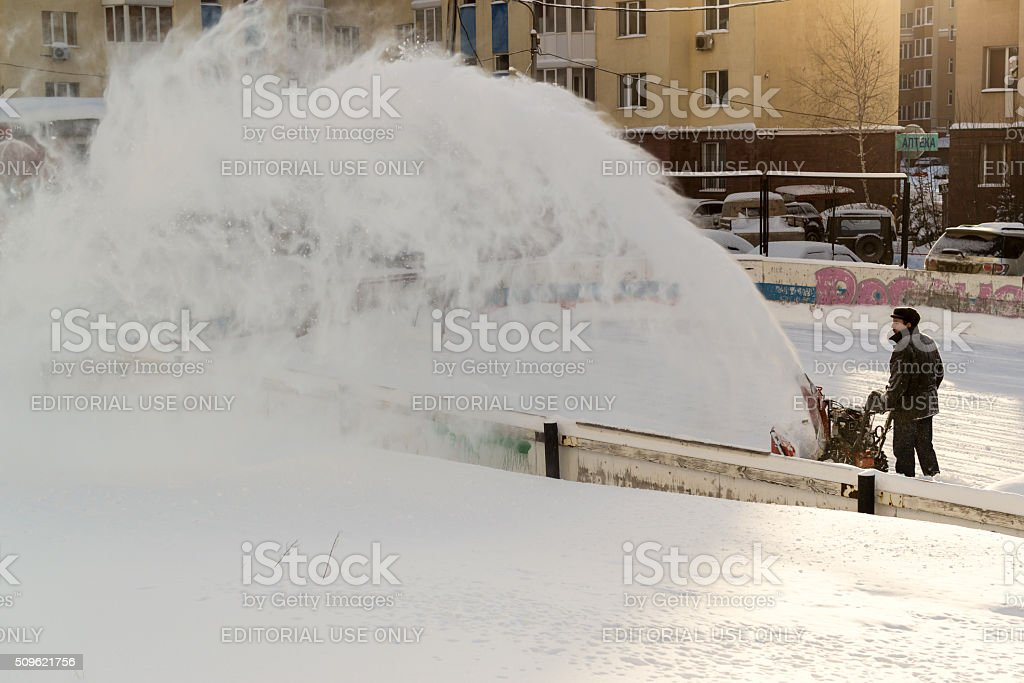 Clearing Snow Machine and Worker at Work stock photo