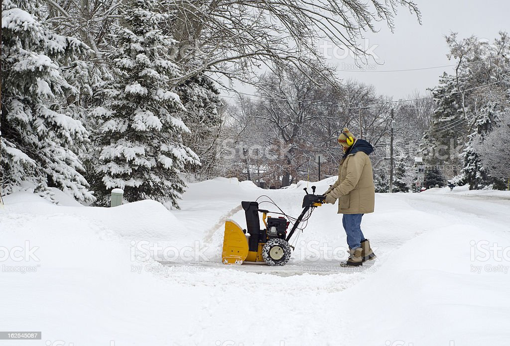 Clearing the Driveway After a Heavy Snow Fall stock photo