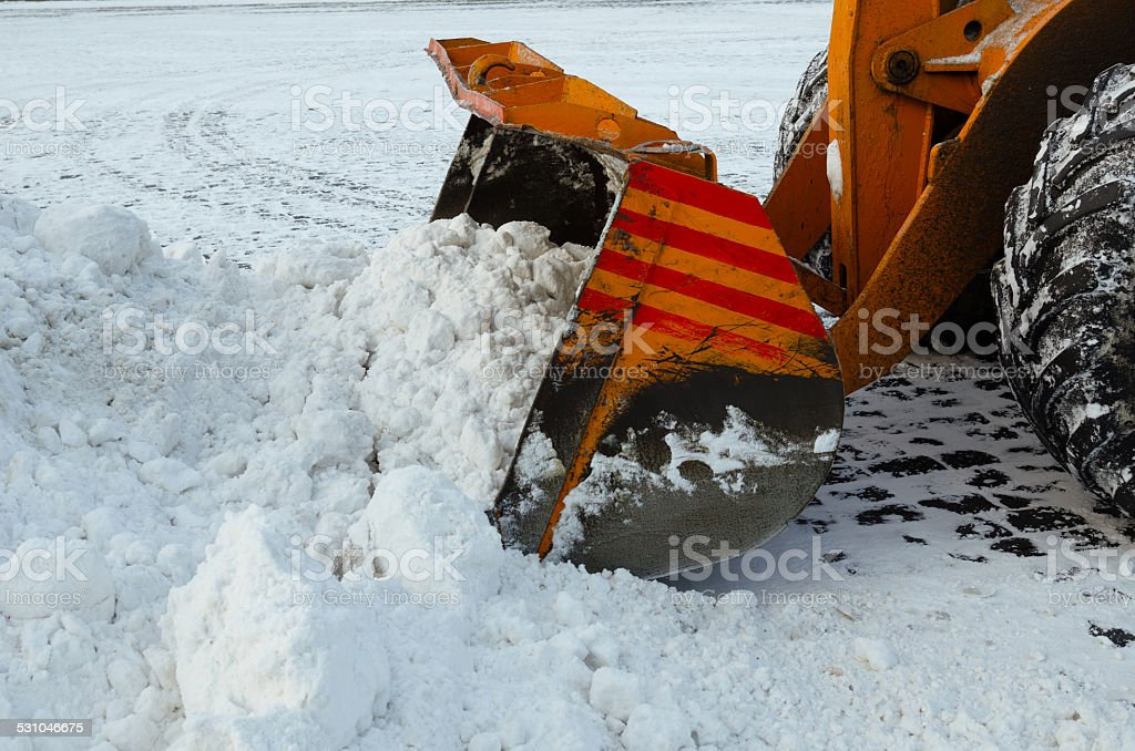 Clearing the road from snow. stock photo